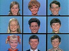 The 9-way split screen with characters of the Brady Bunch in each, from the opening segment