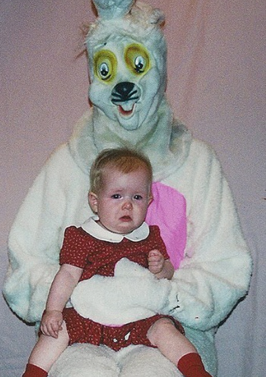 Awful bunny masked-man holds crying baby.