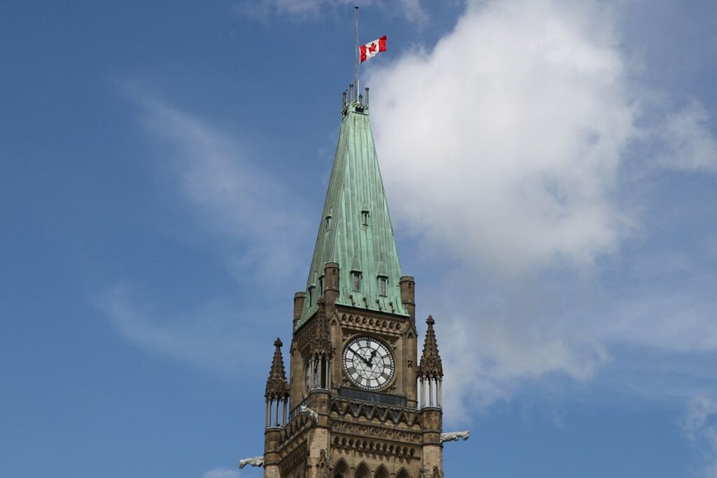 Canadian flag at half mast on the peace tower in ottawa