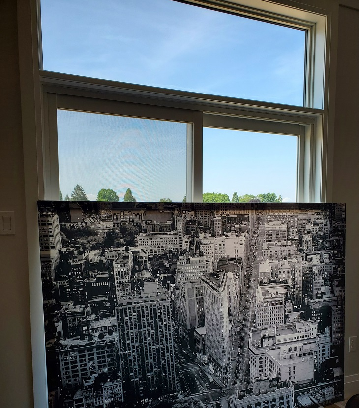 Black and white canvas of New York with the flat-iron building in the middle, covering most of a patio door window.