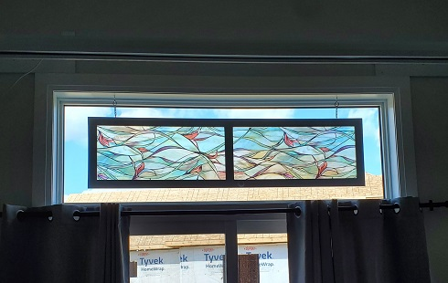 """The finished """"door"""" hangs in the transom looking to the untrained eye like a piece of stained glass."""